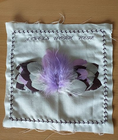 patch showing an angel made out of feathers